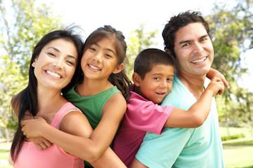 Family of four smiling | Dentist in Loxahatchee, FL