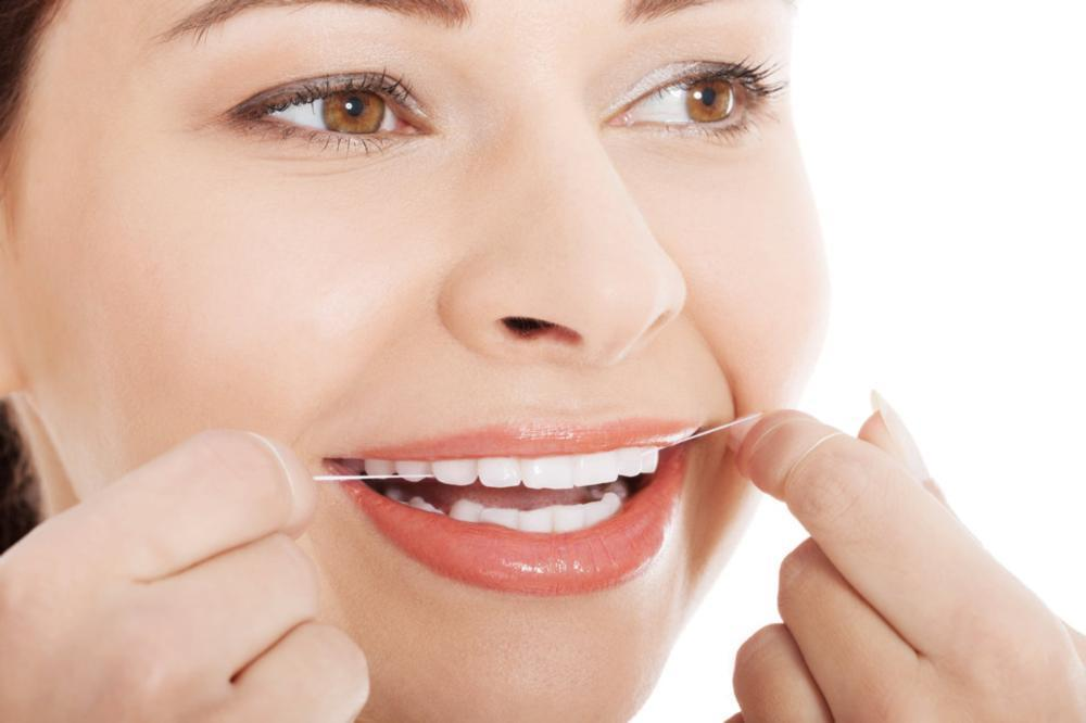Dental Patient Flossing | Dentist Wellington FL