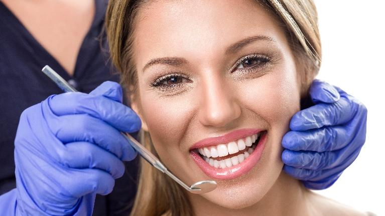 Woman Having Procedure | Groves Dental Care