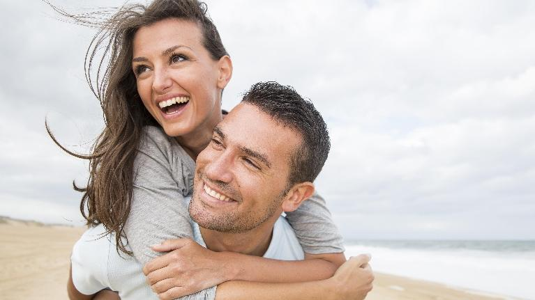 Young Couple Smiling | Groves Dental Care